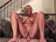 Mature blonde with glasses sucks a salami