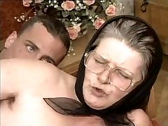 Unshaved Grandma in Glasses and Scarf Fucked