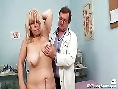 Milena visiting her gyno doctor friend who is opening and gaping her senior mature pussy wide with a speculum.