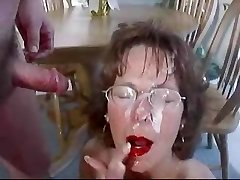 Mature brunette in glasses nourishes huge facial cum-shot.