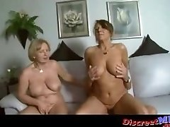 Two buxom cougars in a threesome with one lucky guy