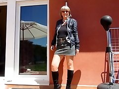 Sexy grandmother in footwear and nylons