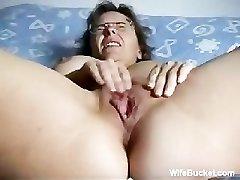 Mature wifey finger-tickling herself