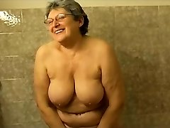 Granny jacking in the bathroom