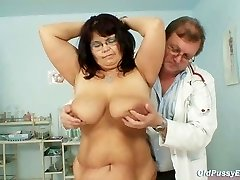 Busty mature gal Daniela breasts and mature pussy gyno exam