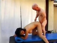 Mature Asian bitch Pinkish Rocket has some fun by the pool with a midgets cock and toys his bootie