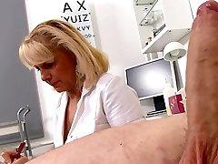 Mature Platinum-blonde Nurse measures patients manhood soft and erect