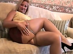 Mature blonde with supreme body in cock-squeezing mini skirt