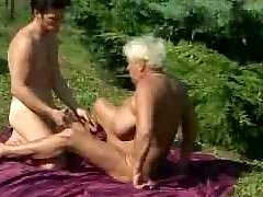 Grandma penetrates outdoors