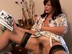 Busty hairy mature brunette honey poses and unclothes