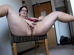 Busty mature BBW in pantyhose and mini mini-skirt