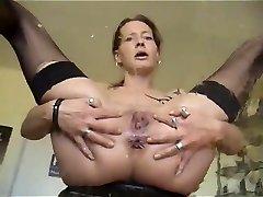 Mature honey masturbating while pissing