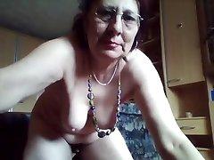 Kinky hairy granny enjoys pissing in the bucket