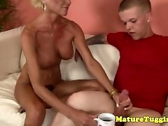 Masturbating grandma gets some cream from a midget