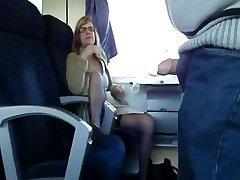 Mature wife fellates in train