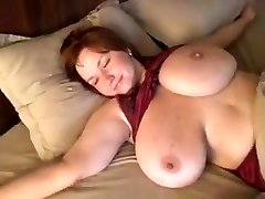 Homemade pin with my redhead wife showing her tremendous boobs