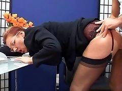 Fashionable mature secretary torn up