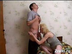 Mature busty bony milf was fucked by neighbor young boy