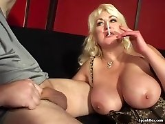 Busty mother gives blowjob and smokes cigarette