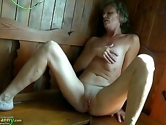 Horny granny with flat globes fingering her vag in sauna