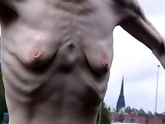 a lean mature lady with small empty saggy tits