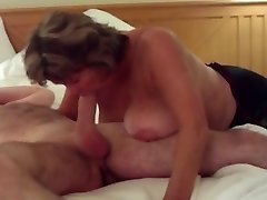 Busty Mature Swallows All of Huge Young Prick