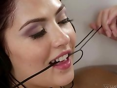 Naughty nubile with horny pussy masturbates with a faux-cock