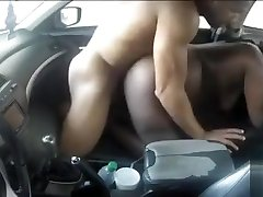 Obese dark-hued mommy jumps on her friend's cock in the car
