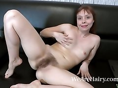 Trixie strips and drains on her black sofa