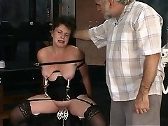 Two old dudes torture mature brunette in dungeon