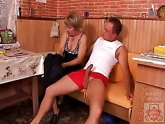 Mature mom and the Sonny's friend have a good time on kitchen.