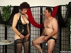Pervert granny in latex gives blowage