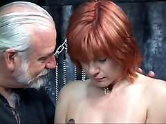 Mature redheaded slave with saggy tits is cropped in hippy's dungeon space
