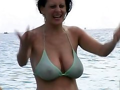 Warm Milf in Swimsuit at The Beach