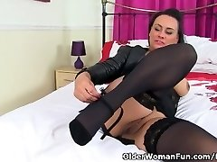 English cougar Eva May dildos her trimmed fanny