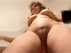 Lovable Mature lady stripping and showing off nice pussy