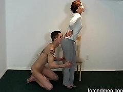 Naked slave licks domina' legs for worship