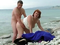 Plumper mom`s fucking, pissing and hairy cream pie on the beach