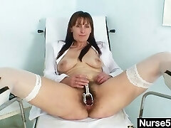 Mature mom Karin shows off hairy pussy