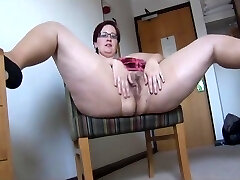 Busty mature BBW in pantyhose and mini skirt disrobing