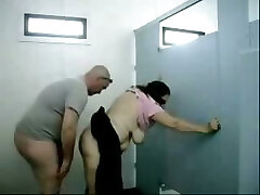 Senior dude fucks this chubby big-chested granny in a public toilet
