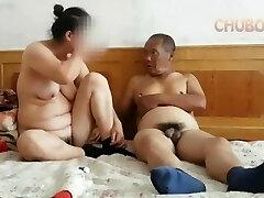 Chinese grandpa providing it to grandma from behind