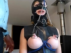 Slave has hooks in breasts