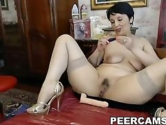 Busty mature babe toying both her fuck-holes on web web cam