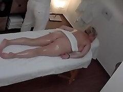 Mature Blonde Boob in a Massage Parlor
