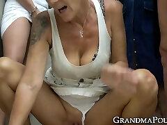 Four lustful grannies working on big young boner together