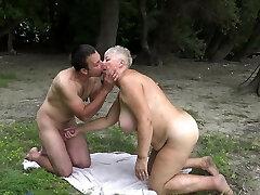 Nudist fucks grannie in public