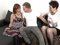 Slutty matures are wearing erotic tights while having a three-way with a younger guy they like