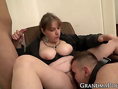 Authoritative granny submits two dicks to her rule