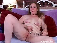 Kinky senior spunker in beautiful stockings strips and has a nice little wank